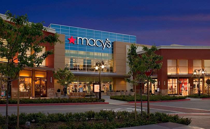 Macy's reports positive comparable sales growth, initiates restructuring plan