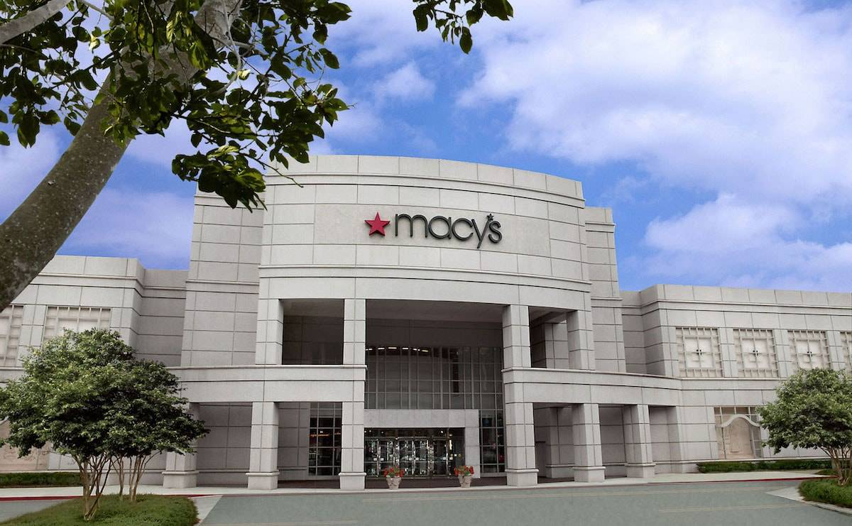 Macy's lowers full year earnings outlook